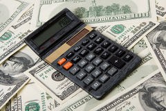 Calculator en geld Stock Afbeelding