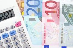 Calculator en geld Stock Afbeelding