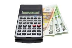 Calculator en geld stock fotografie