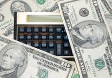 Calculator en geld Stock Foto's