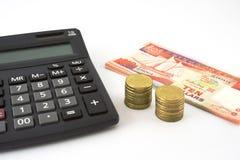 Calculator en geld Royalty-vrije Stock Afbeelding
