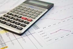 Calculator en grafiek Stock Foto
