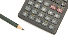 Calculator en potlood royalty-vrije stock fotografie