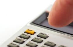 Calculator en vinger Stock Foto
