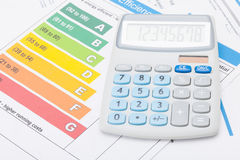 Calculator with energy efficiency chart. Studio shot royalty free stock photography