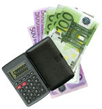 Calculator with Euro bank notes Royalty Free Stock Photography