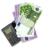 Calculator with Euro bank notes royalty free stock photos