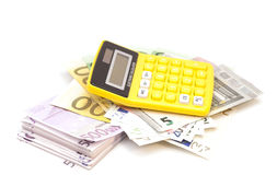 Calculator with euro bank notes Stock Image