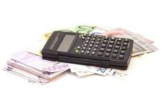 Calculator with euro bank notes Stock Photo