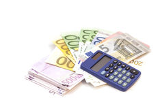 Calculator with euro bank notes Royalty Free Stock Images