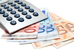 Calculator on the euro banknotes Royalty Free Stock Images