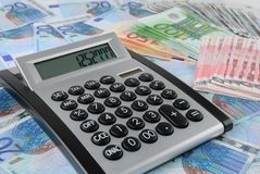 Calculator on Euro banknotes Stock Photo