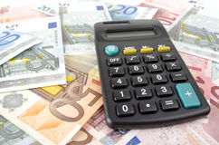 Calculator and euro banknotes Stock Photo