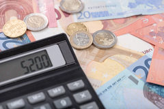 Calculator on euro banknotes Royalty Free Stock Photography