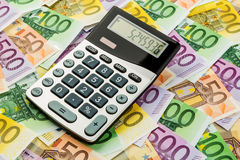 Calculator and euro banknotes Stock Image