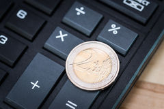 Calculator and 2-euro coin Royalty Free Stock Image
