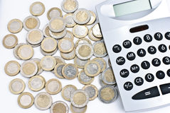 Calculator with euro coins Stock Photos