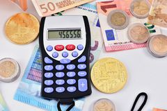 Calculator euro notes and coins and virtual money. Isolated Royalty Free Stock Photos