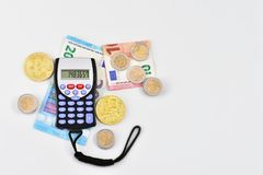 Calculator euro notes and coins and virtual money. Isolated Royalty Free Stock Photo