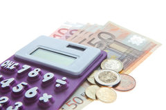 Calculator, Euro Notes And Euro coins isolated on white Stock Image