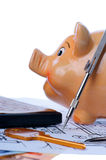 Calculator and euromoney note. Brown calculator, compass, project, Piggy bank and euromoney, bill Royalty Free Stock Photos
