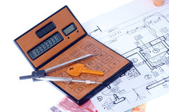 Calculator and euromoney note. Brown calculator, compass, project, Piggy bank and euromoney, bill Stock Photo