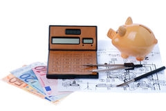 Calculator and euromoney note. Brown calculator, compass, project, Piggy bank and euromoney, bill Royalty Free Stock Image