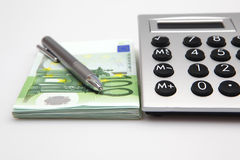 Calculator with euros and pen Royalty Free Stock Photography