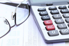 Calculator and eye glasses on bank statement Stock Photography