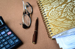 Calculator eyeglasses and notebook Royalty Free Stock Images