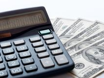 Calculator and fan 100 dollars bills. Calculator and fan of 100 dollars bills Royalty Free Stock Images
