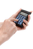 Calculator in feminine hand Stock Images