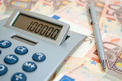 Calculator on the fifty-euro banknotes Royalty Free Stock Image