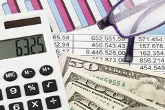 Calculator and figures Stock Images