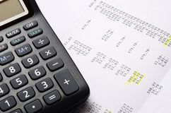Calculator on figures listing. For accounting background Stock Image