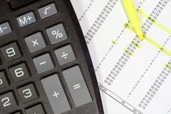 Calculator and Financial Data. This is an image of a calculator and financial report with a highlighter stock photos