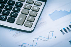 Calculator on Financial Data Graphs Stock Photo