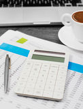 Calculator and financial papers Stock Image