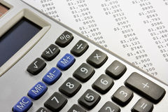 Calculator and financial report. Electronic calculator on a financial report Royalty Free Stock Images