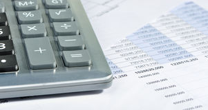 The calculator and the financial report Stock Photography