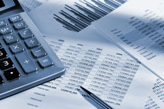 The calculator and the financial report Royalty Free Stock Images
