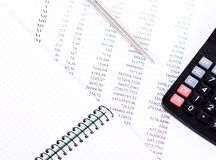 Calculator and the financial report Royalty Free Stock Images