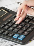 Calculator and the financial report Royalty Free Stock Image