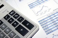 Calculator and financial report. Royalty Free Stock Photography