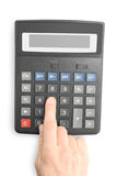 Calculator with finger Stock Images