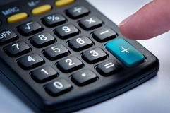 Calculator with finger closeup. Stock Photo