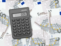 Calculator on five euro background Stock Image