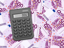 Calculator on five hundred euro background Stock Photo