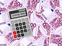 Calculator on five hundred euro background Stock Images