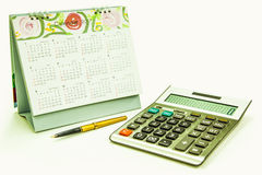 Calculator fountain pen and calendar Royalty Free Stock Images